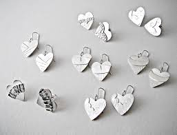 sterling silver ear studs in the design of heart shaped clothing