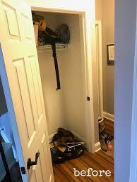 pretty distressed hall closet turned mini mudroom makeover