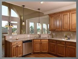 what color to paint kitchen with maple cabinets kitchen paint colors with maple cabinets and chandelier