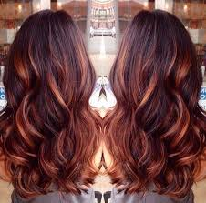 brunette hairstyle with lots of hilights for over 50 dark brown hair with caramel highlights and red lowlights hair