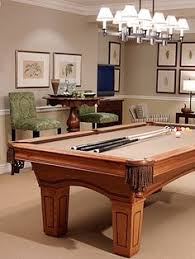 james teak pool table can be hidden away to become a dining
