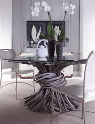 chronograph knot dining table in driftwood finish by curate home