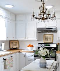 white painted kitchen cabinets with brass hardware jennifer rizzo