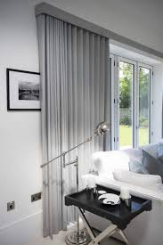Drapes Over French Doors - ripple fold curtains on tracks over bifold doors interiors l