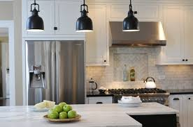white kitchen with black industrial lighting and white quartz