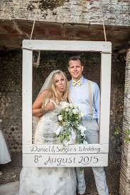 photo booth wedding rustic outdoor festival feel yellow blue summer wedding photo