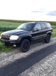 2000 gold jeep grand cherokee 2000 wj limited daily driver any suggestions on a lift and tires