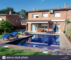 view of a swimming pool attached to a house stock photo royalty