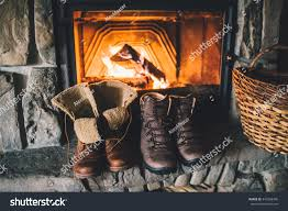 winter boots front fireplace family vintage stock photo 345268340