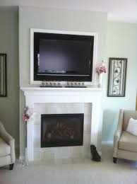 tile faced fireplace custom wood surround tv above modern