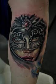 women mask tattoo by silence of art tattoo studio