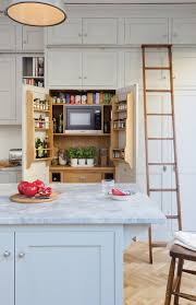 how to decorate space above kitchen cabinets how to fill the space above kitchen cabinets