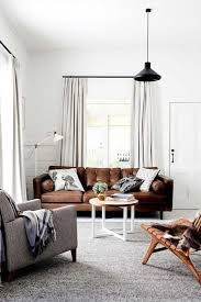Large Brown Leather Sofa Living Room Design Leather White Walls Brown Grey Rug