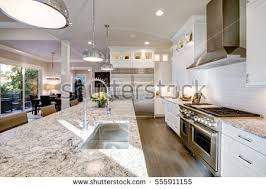 kitchen islands with granite countertops white kitchen design features large bar stock photo 555911155