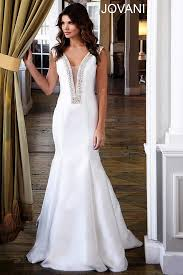 wedding dress indo sub white sleeveless mermaid gown with a sheer plunging neckline