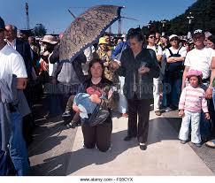 pilgrimage to fatima fatima pilgrim pilgrimage kneeling stock photos fatima pilgrim