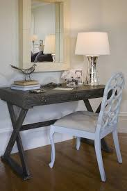 chic office space with arteriors cain gray limed oak desk white chair hourglass lamp and mirror
