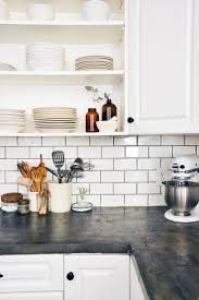 grey and white kitchen with white subway tile traditional l