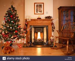 living room with open christmas decorations and tree