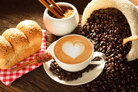cafe latte a cup of cafe latte with coffee beans and bread i hd images