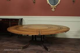classic dining room design with large round expandable dining