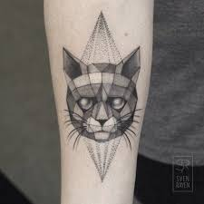 cool dot style forearm tattoo of mysterious cat with cool eyes