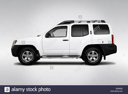 nissan white 2010 nissan xterra s in white drivers side profile stock photo