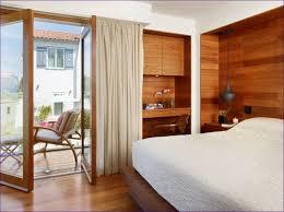 bedroom bedrooms with hardwood floors and area rugs black