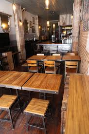 bar stools tables and chairs at black tree restaurant were