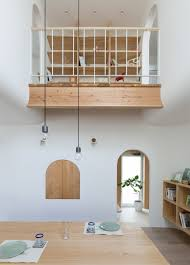 compact home in japan looks enchanting with arches and curves curbed