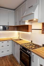 colored kitchen cabinets with stainless steel appliances light gray kitchen interior with modern cabinets and stainless steel appliances