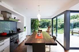 floor to ceiling glass doors kitchen room plc lighting polka dot wallpaper white sofa glass