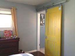 spectacular yellow painted single sliding barn doors for homes