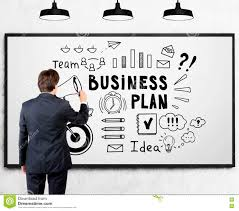 man drawing a business plan sketch on whiteboard stock photo
