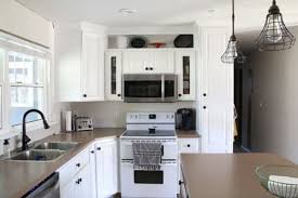 Spray Painting Kitchen Cabinets White How To Spray Paint Cabinets Like The Pros Bright Green Door
