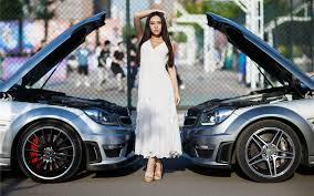 mercedes c63 amg wallpaper haired between the bumpers of two mercedes c63 amg