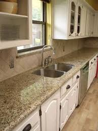 Countertop Backsplash Combinations by Brown Granite In A Beautiful White Kitchen In A Model Home In