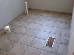 we used a gray sanded grout which accented the tiles well the