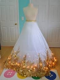 light up christmas skirt she glues christmas garland to the hem of a dress when she flips