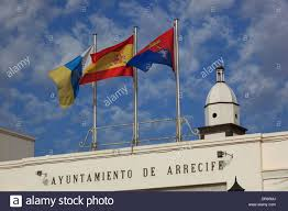 flag of spain canary islands lanzarote infront of the tower of