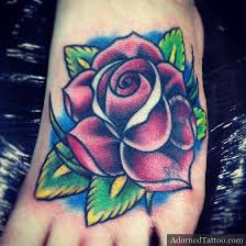 traditional rose tattoo on foot adorned tattoo