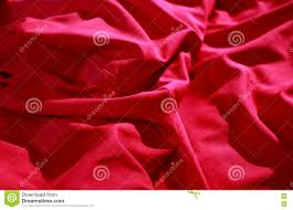 bed linen shop wrinkles on the red silk vail detailed stock image