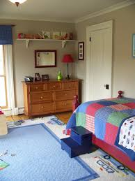 bedroom area rug and dresser with bedding also window treatments