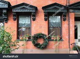 black vintage windows decorated corbels wreath stock photo