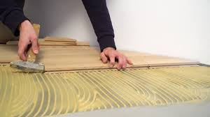 Laminate Flooring Construction Worker Installing Wood Parquet Construction In A Renovated Room