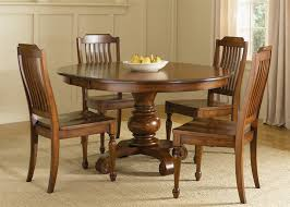 5 pc dining table set the most round pedestal table 5 piece dining set in chestnut finish