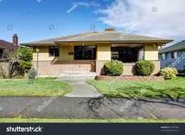 small american yellow brick rambler house stock photo 97976399