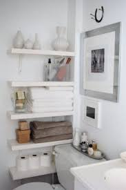 bathroom white wall mounted bathroom towel and utility storage