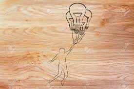 balloons shaped like light bulbs person flying by holding up to lightbulb shaped balloons stock photo