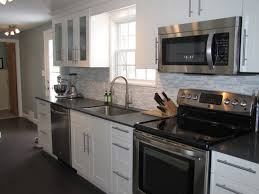 white kitchen cabinets with black appliances kitchen island
